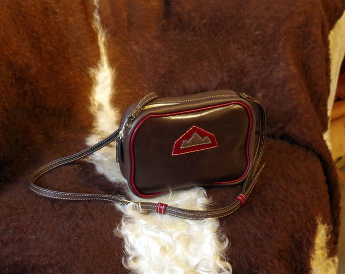 small red and brown leather shoulder bag