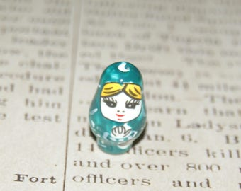 Russian doll 22x13mm green ceramic bead