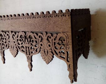 Folk wooden openwork shelf