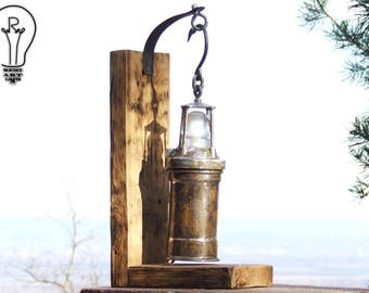 Unique miner lamp hanged on reclaimed wood