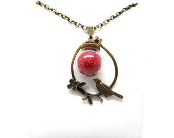 The bird, red glass globe necklace
