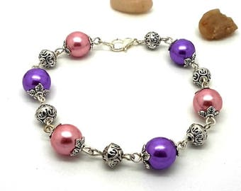 Silver bracelet, pink and purple beads