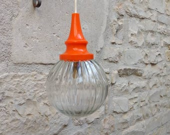Retro French vintage multifaceted heavy glass pendant light shade with orange sleeve circa 1970s.