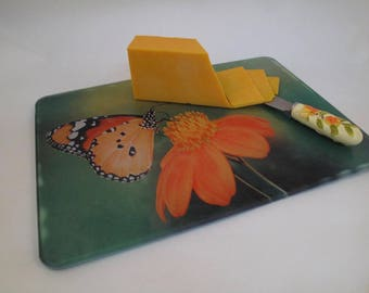 Summer Butterfly and Flower Glass Cutting / Cheese Board with green blur background