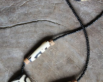 African necklace with batik bone beads from South Africa. A  minimalist necklace that is Unisex.  Bijoux ethniques. Rustic tribal organic