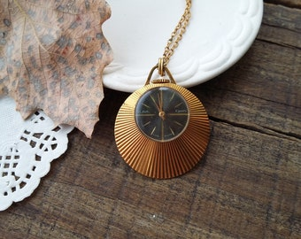 A beautiful gilded pendant watch from the USSR, A rare elegant model, a stylish accessory for a stylish woman, produced in the mid 80's