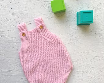 Pink hand knitted baby dungaree romper