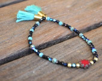 red flower charm beaded bracelet