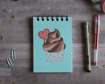 NOTEPAD. A6 Cute Cupcake Spiral Notepad. Soft 300 gsm Card Cover. 120 blank pages. Matte lamination pleasant to the touch.