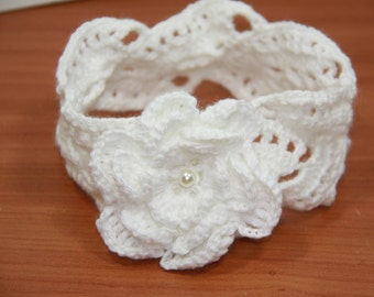 White headband with its 2/3 years with crochet flower.