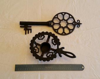 antique black cast iron decorative key & voltive candle holder - vintage wrought metal trivet skelton castle prison wall hanging rustic art