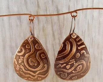 Bold, etched copper teardrop-shaped earrings