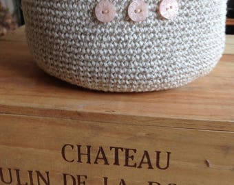 Cotton and linen crochet basket with small pink buttons