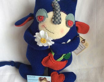 Wool stuffy monster, made from repurposed sweater. Huggable and sweet toy or collectible.