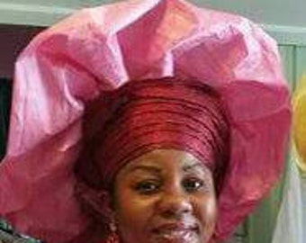 Baby pink and burgundy mixed gele by Lois Crystal.