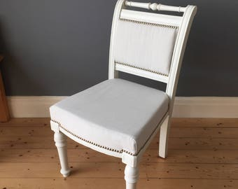 Beautiful Refurbished and re-upolstered vintage hand carved wooden chair