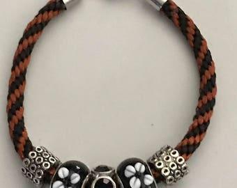 Handwoven black and orange kumihimo beaded bracelet
