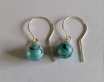 Earrings with turquoise ball