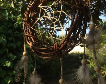Dream catcher made of Twigs and Hemp Contains Aquamarine Stone in center of Web