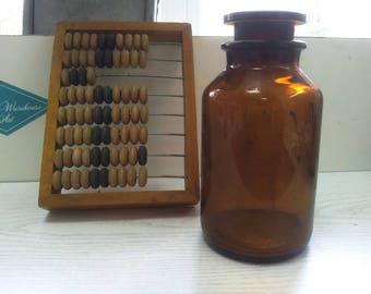 vintage pharmacy glass jar and Soviet abacus