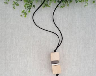 Handmade necklace made of wood blocks, polymer clay and suede.