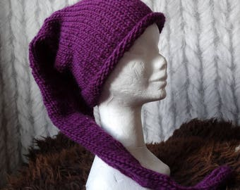Hand knitted long purple pointy hat with a small bell. Adult size.