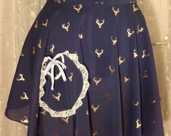 Women's half apron in silky sheer navy with golden deer head print