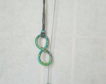 Infinity lariat necklace with dangle