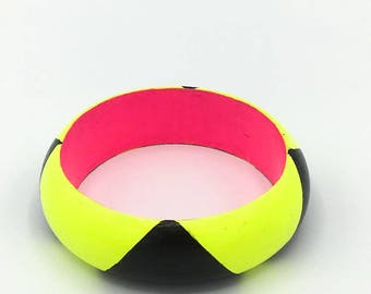 Handmade  bright geometric wooden bangle in neon yellow, black and neon pink