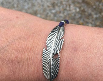 Feather and suede bracelet