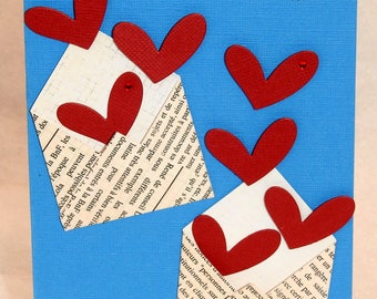 Card with envelopes and gone red hearts Valentine