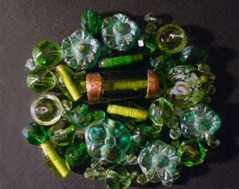 55 green Indian glass beads, gold in various shapes