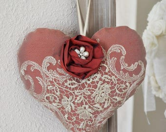 Romantic heart and red silk flower