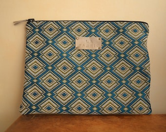 Blue and beige geometric patterned cover