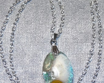 Crystal resin pendant with shells and sea glass from Scottish beaches hung on a silver plated bail and chain