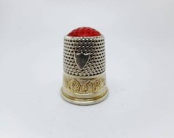 An Austrian silver / silver gilt stone top thimble. c 1870