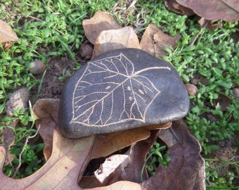 Hand carved black river rock paulownia leaf
