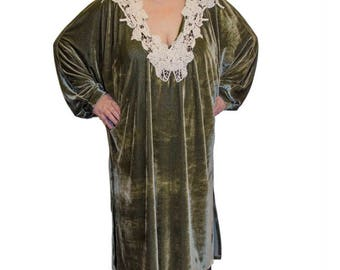 Green velvet caftan with white lace on the neck