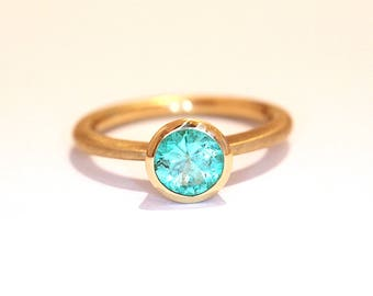 18k gold engagement ring with emerald