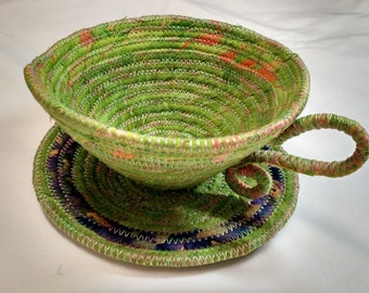 cup and saucer green/orange