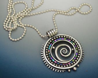 Sterling silver pendant necklace with peacock colored iridescent Hematite beads and sterling bead mosaic inlay polymer clay.