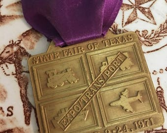 1971 State Fair of Texas Employee Badge  Assistant Ticket Auditor  October 1971 Theme Expo Transport  Brass Employee Badge  Purple Ribbon