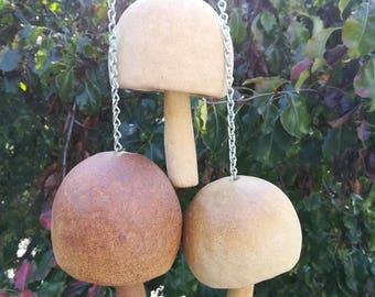 Ceramic wind chime. Mushroom stone dinner bell, ceramic garden art gift. Indoor or outdoor dinner bell, wind chime. White and brown, metal.
