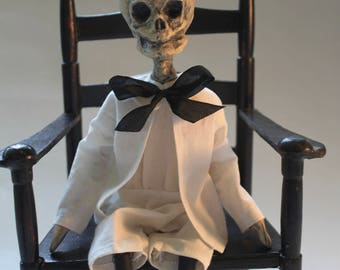 Vinegar Doll Quentin by William Bezek, a dead Edwardian child fetal skeleton art doll.
