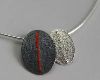 Oxidised and Silver oval discs pendant stitched with embroidery thread