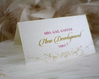 Escort cards / Place cards / Seating cards / Tricilia Collection / Flourish / Shimmery ivory / Gold / Fuchsia