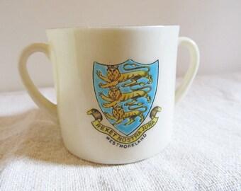 Two handled English porcelain souvenir cup by Clifton Windermere viking ship lions passant