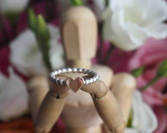 An adorable dainty sterling silver and 9ct rose gold heart stacking midi ring on a band of little silver spheres.......