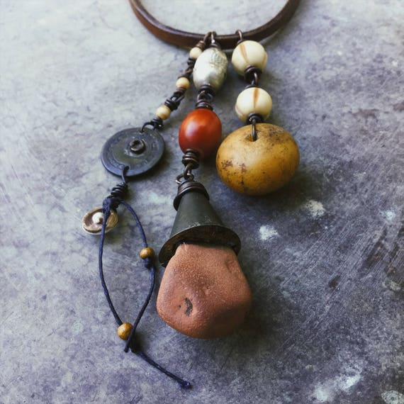 Tribal talisman necklace - found stone, African amber, bone beads, rustic leather chord