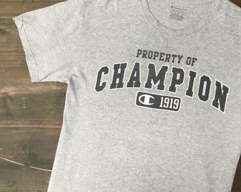 Property Of Champion T-Shirt